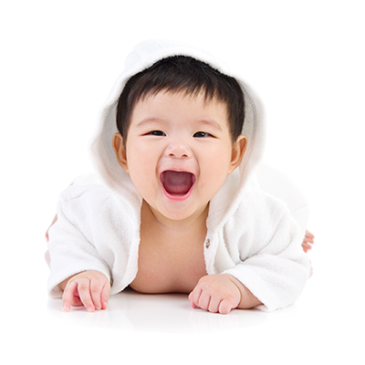 Photo of a happy baby in a towel