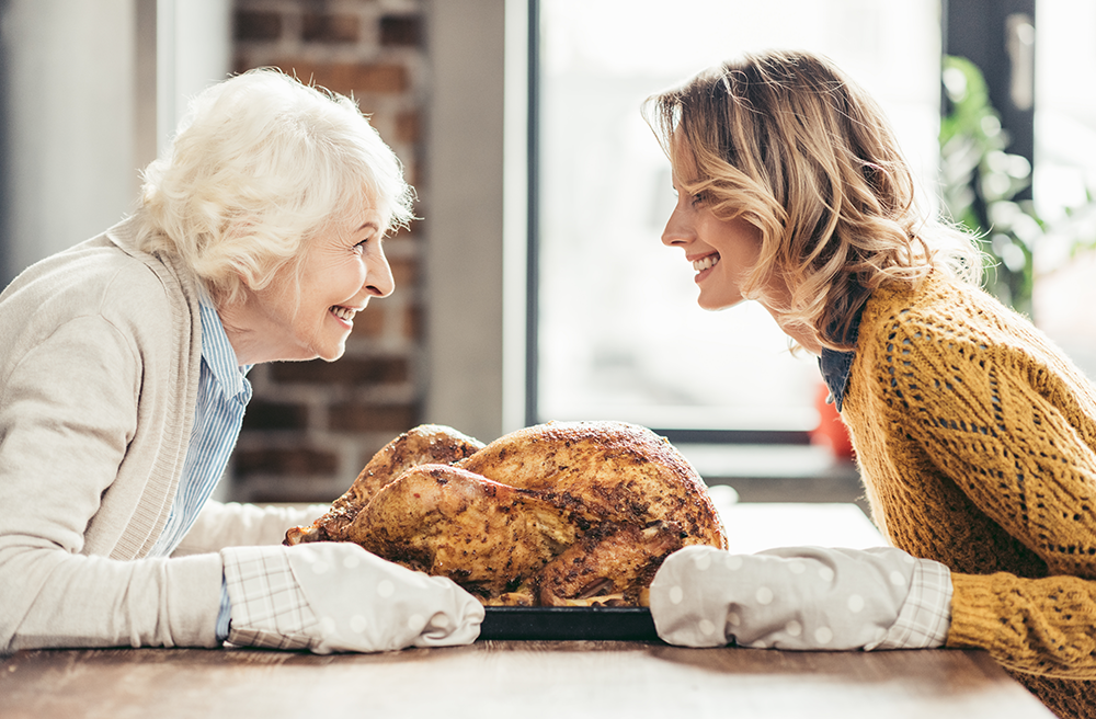 Photo of a woman and her grandmother with a turkey